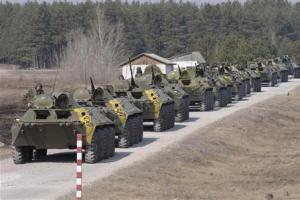 Ukrainian soldiers ride on military armoured personnel…
