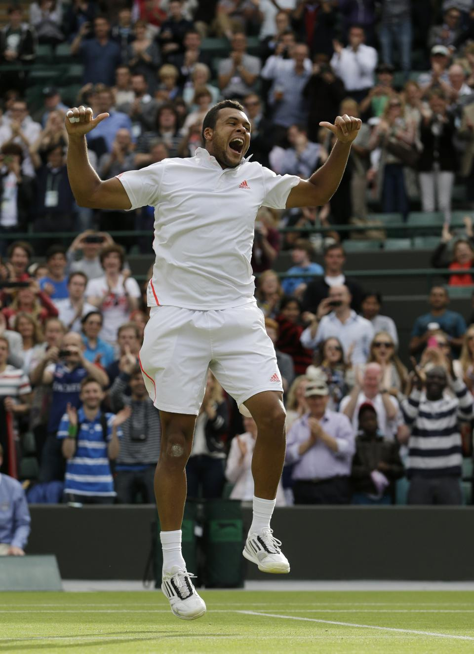 Jo-Wilfried Tsonga of France reacts after defeating Philipp Kohlschreiber of Germany during a quarterfinals match at the All England Lawn Tennis Championships at Wimbledon, England, Wednesday, July 4, 2012. (AP Photo/Kirsty Wigglesworth)