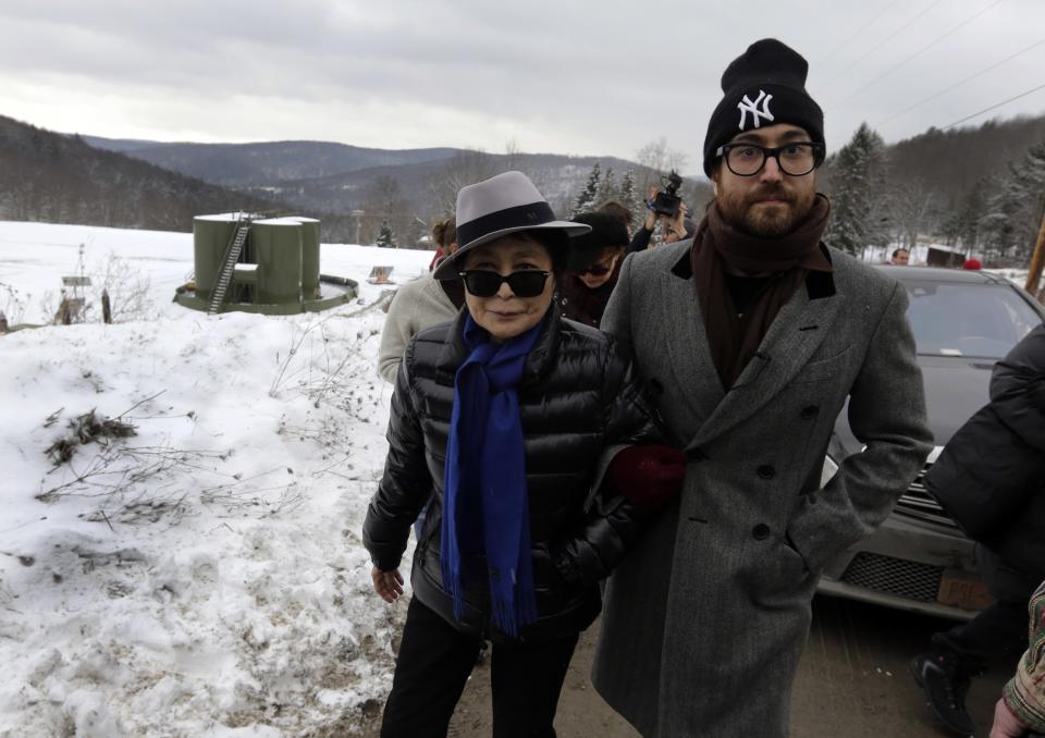 Yoko Ono, left, and her son Sean Lennon visit a fracking site in Franklin Forks, Pa., Thursday, Jan. 17, 2013. They are on a bus tour of natural-gas drilling sites in northeastern Pennsylvania and plan to visit with residents who say they've been harmed by the controversial extraction process known as fracking.(AP Photo/Richard Drew)
