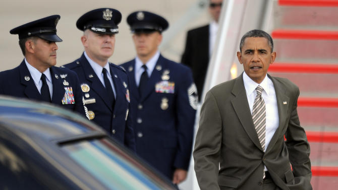 President Barack Obama arrives at Buckley Air Force Base in Aurora, Colo., on Saturday, Sept. 1, 2012. President Obama is in the state for a campaign event in Boulder, Colorado. (AP Photo/Chris Schneider)