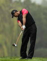 Tiger Woods tees off on the fifth hole during the final round of the World Challenge golf tournament at Sherwood Country Club in Thousand Oaks, Calif., Saturday, Dec. 2, 2012. (AP Photo/Bret Hartman)