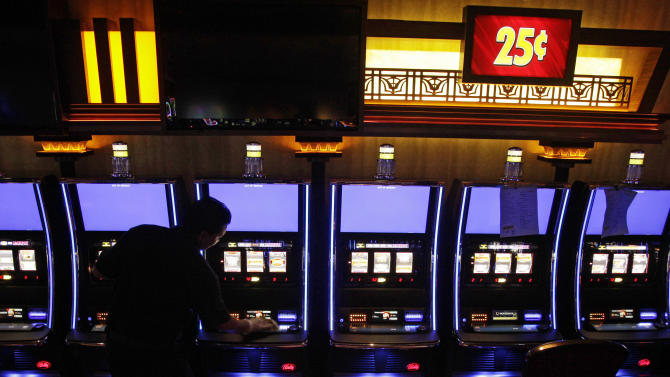 In this May 9, 2012 photo, Rudra Khadka cleans slot machines inside the new Horseshoe Cleveland Casino. Ohio's first casino is scheduled to open to the public on Monday, May 14, 2012. (AP Photo/Amy Sancetta)