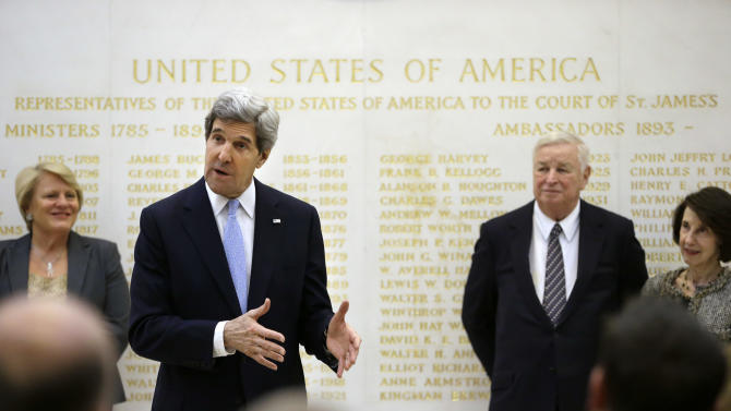 U.S. Secretary of State John Kerry, second from left, speaks alongside U.S. Ambassador Louis Susman, third from left, during a visit to the U.S. Embassy, London, Monday, Feb. 25, 2013. Kerry was in London for the first leg of his debut overseas trip — a hectic nine-country dash through Europe and the Middle East. (AP Photo/Jacquelyn Martin, Pool)
