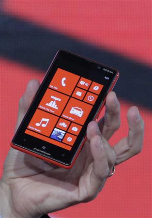 A Nokia executive shows a new Lumia phone with Microsoft's Windows 8 operating system at a launch event in New York