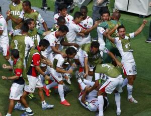 Costa Rica's players celebrate after their teammate Ruiz scored a goal against Italy during their 2014 World Cup Group D soccer match at the Pernambuco arena in Recife