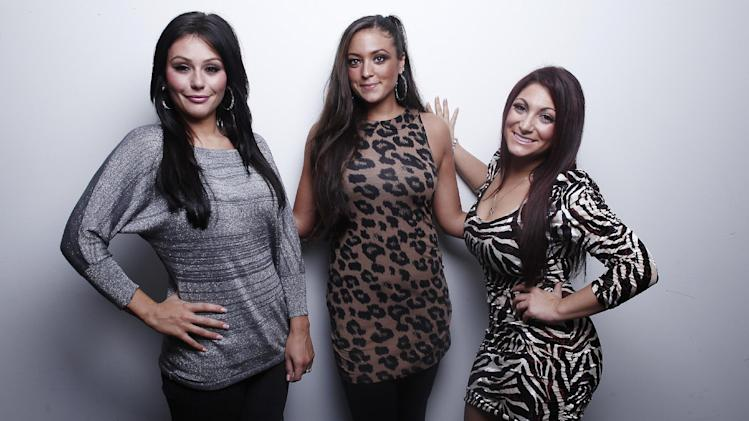 "This Oct. 3, 2012 photo shows cast members from ""Jersey Shore,"" from left, Jenni ""JWOW"" Farley, Sammi ""Sweetheart"" Giancola and Deena Cortese pose for a portrait in New York. The final season of the MTV reality season premieres on Thursday. (Photo by Carlo Allegri/Invision/AP Images)"