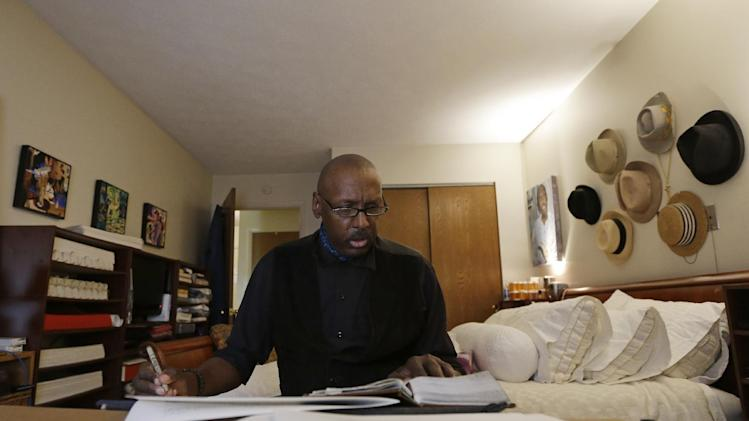 Phillip Patterson transcribes the King James Bible at this home on Tuesday, April 30, 2013, in Philmont, N.Y. (AP Photo/Mike Groll)