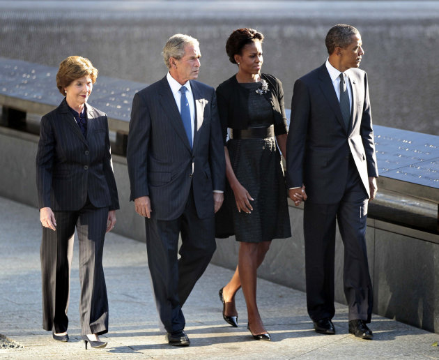 President Barack Obama and first lady Michelle Obama former President George W. Bush and former first lady Laura Bush visit North Memorial Pond at the...