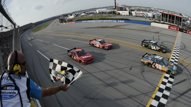 Joey Logano (18) passes Kyle Busch (54) to win the Nationwide Series auto race at the Talladega Superspeedway in Talladega, Ala., Saturday, May 5, 2012. (AP Photo/Jared Tilton, Pool)