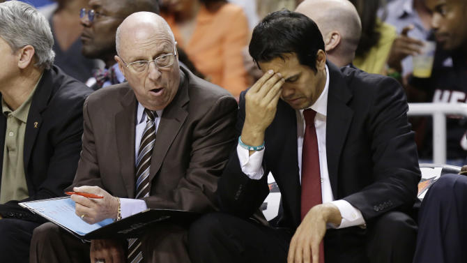 Miami Heat assistant coach Ron Rothstein talks to head coach Erik Spoelstra, right, during the second half of a NBA basketball game in Miami, Friday, March 22, 2013 against the Detroit Pistons. The Heat won 103-89. (AP Photo/J Pat Carter)