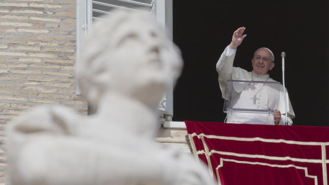 Pope Francis delivers his blessing to the crowd gathered in St. Peter's Square at the Vatican to attend the Angelus noon prayer he celebrated from the window of his studio, Sunday, Feb. 16, 2014. (AP Photo/Andrew Medichini)