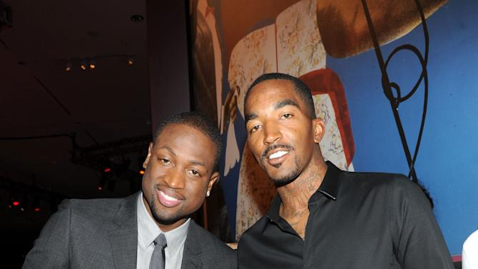 """NBA champion and Miami Heat shooting guard Dwyane Wade, left, and New York Knicks' guard J.R. Smith, celebrate the launch of Wade's first book """"A Father First: How My Life Became Bigger Than Basketball,"""" at a party hosted by ESPN The Magazine, Tuesday, Sept. 4, 2012, at Jazz at Lincoln Center in New York.   (Diane Bondareff/Invision for ESPN The Magazine/AP Images)"""