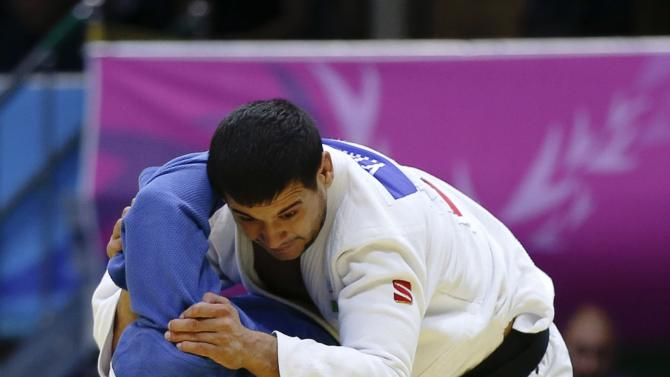 Uzbekistan's Yakhyo Imamov competes with Japan's Keita Nagashima during their men's -81kg bronze medal match at Dowon Gymnasium during the 17th Asian Games in Incheon