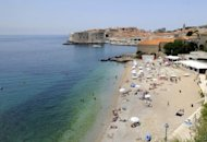 Tourists enjoy the summer on the main beach of Croatia's central Adriatic resort of Dubrovnik in 2009. Croatia, whose tourism-oriented economy has been in recession for most of the time since 2009, expects to see its earnings from visitors grow by up to five percent this year, a minister said Monday