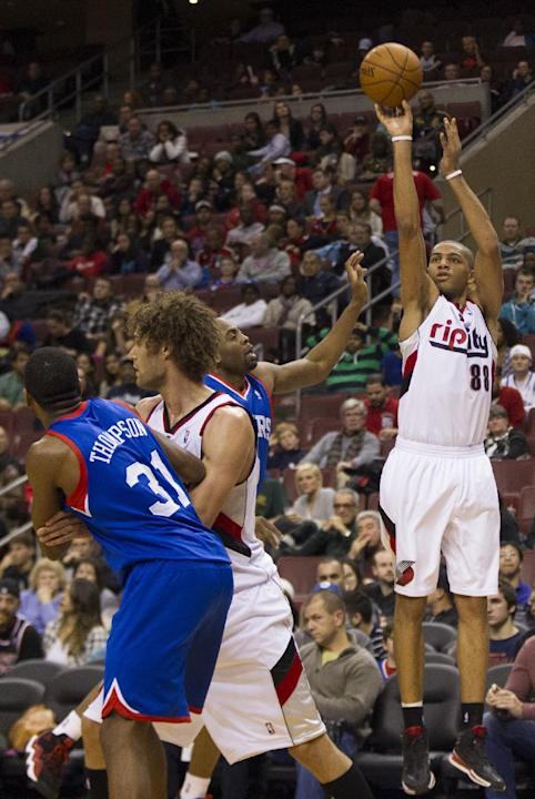 Portland Trail Blazers' Nicolas Batum, right, of France, shoots the ball with Philadelphia 76ers' James Anderson, center right, coming over to defend as 76ers' Hollis Thompson, left, tries