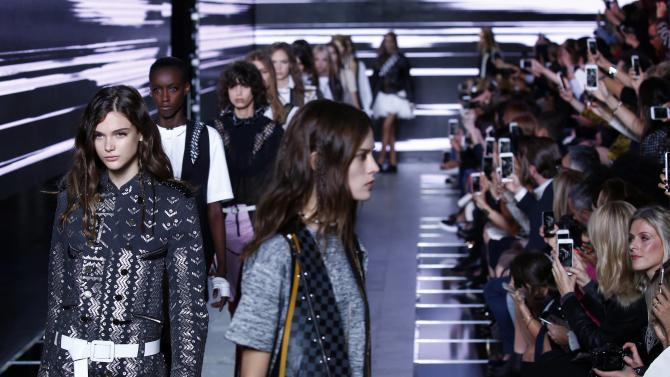 Models present creations by French designer Nicolas Ghesquiere as part of his Spring/Summer 2016 women's ready-to-wear collection for fashion house Louis Vuitton in Paris