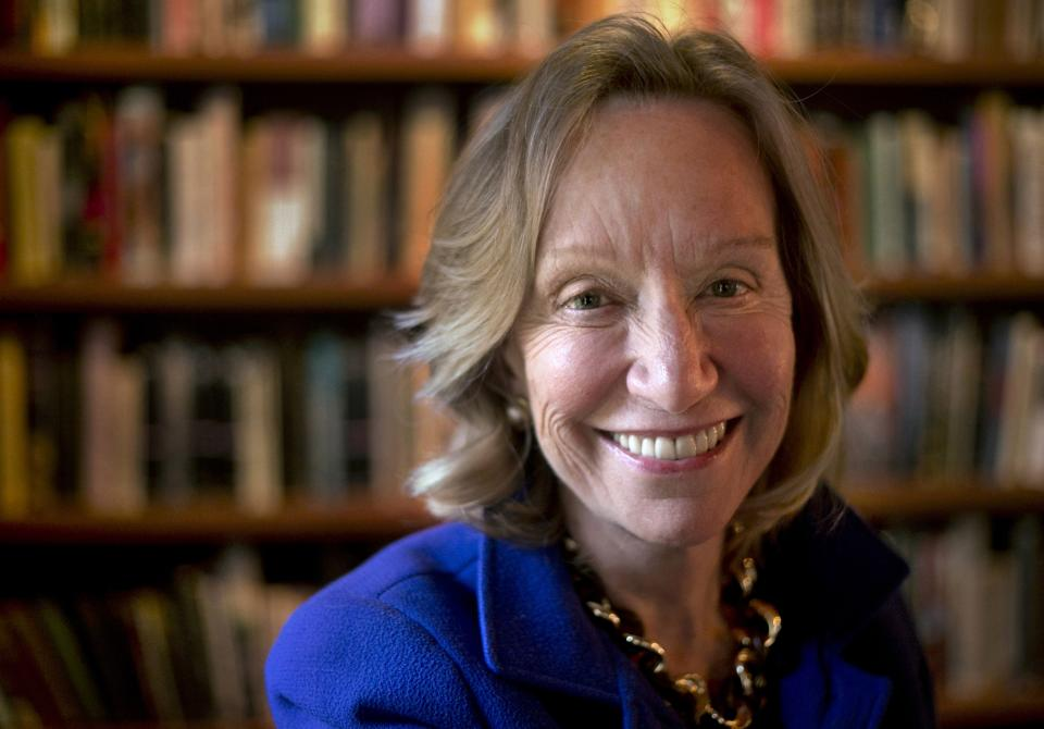 "In this Monday, Oct. 7, 2013 photo author Doris Kearns Goodwin stands near a bookshelf for a portrait at her home in Concord, Mass. Goodwin's latest book,""The Bully Pulpit: Theodore Roosevelt, William Howard Taft, and the Golden Age of Journalism,"" will be released on Nov. 5. (AP Photo/Steven Senne)"