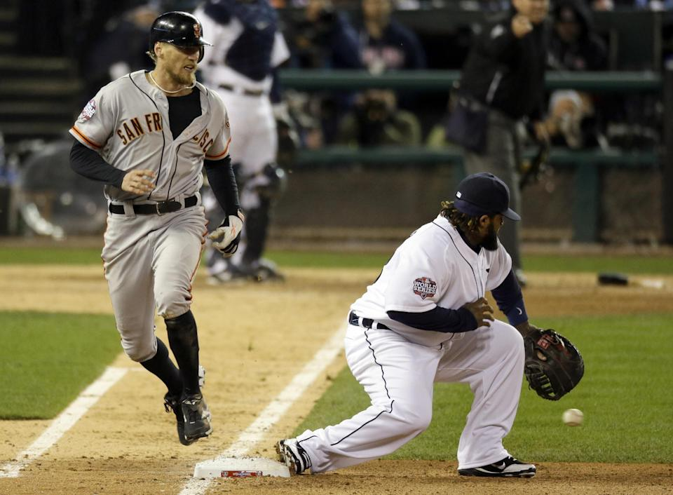 San Francisco Giants right fielder Hunter Pence runs safely to the first as Detroit Tigers first baseman Prince Fielder reaches for the ball during the sixth inning of Game 3 of baseball's World Series against the Detroit Tigers Saturday, Oct. 27, 2012, in Detroit. (AP Photo/Carlos Osorio)