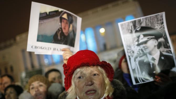 People hold pictures Ukrainian army pilot Savchenko as they take part in a rally demanding her liberation by Russia, at Independence Square in central Kiev
