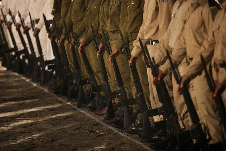 Israeli soldiers stand during a service marking Memorial Day at the Western Wall, the holiest site where Jews can pray, in Jerusalem's Old City, Tuesday, April 24, 2012. Israelis marked Memorial Day starting Tuesday evening in remembrance of the nation's fallen soldiers. (AP Photo/Bernat Armangue)