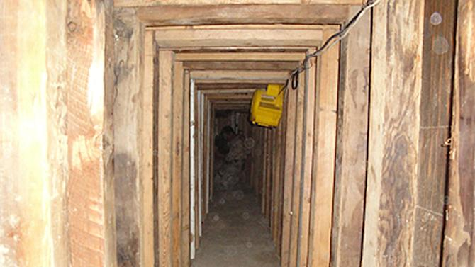 In this undated photo provided by the United States Drug Enforcement Administration, shows a 240-yard, a complete and fully operational drug smuggling tunnel, from the U.S. side of the tunnerl, that ran from a small business in Arizona to an ice plant on the Mexico side of the border, Thursday, July 12, 2012, in San Luis, Ariz.(AP Photo/Drug Enforcement Administration)