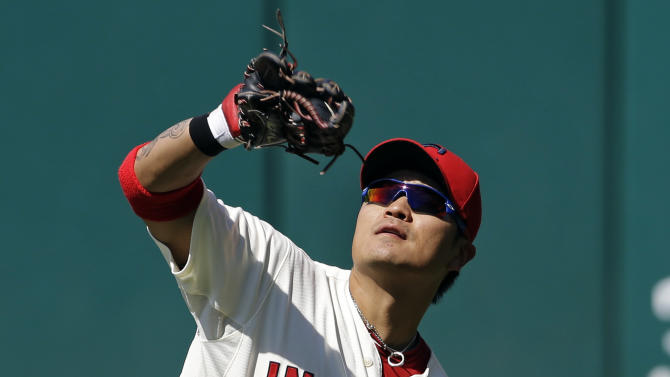 FILE - In this Aug. 26, 2012, file photo, Cleveland Indians right fielder Shin-Soo Choo, from South Korea, catches a fly ball off the bat of New York Yankees' Chris Stewart in the seventh inning of a baseball game in Cleveland. The Indians traded Choo to the Cincinnati Reds and acquired prized pitching prospect Trevor Bauer from the Arizona Diamondbacks in a three-team deal Tuesday, Dec. 11. (AP Photo/Mark Duncan, File)
