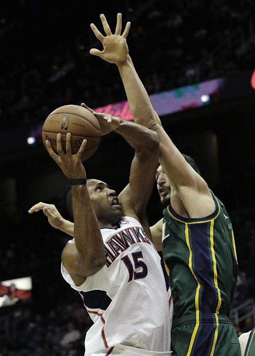 Atlanta Hawks center Al Horford (15) goes to the basket against Utah Jazz center Enes Kanter (0) in the second half of an NBA basketball game on Friday, Dec. 20, 2013, in Atlanta