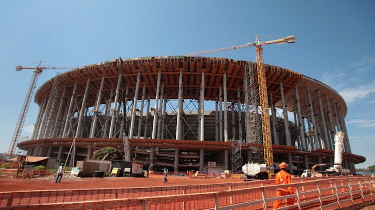 Construction continues at Brasilia's National Stadium in Brasilia, Brazil, Wednesday, Sept. 26, 2012. According to Portal da Copa, a Brazilian federal government website, over 70% of the work is finalized. Brasilia will host the opening match of the 2013 FIFA Confederations Cup and will also be one of the host cities for the 2014 FIFA World Cup soccer tournament. (AP Photo/Eraldo Peres)