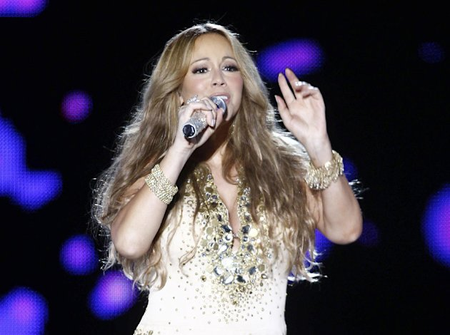FILE - This May 26, 2012 file photo shows U.S. Singer Mariah Carey performing on stage during a concert at the Mawazine Festival in Rabat, Morocco. Carey will be joining the cast of &quot;American Idol.&quot; She told a meeting of the Television Critics Association that she is excited to join as a judge and it all happened quickly. (AP Photo/Abdeljalil Bounhar, file)