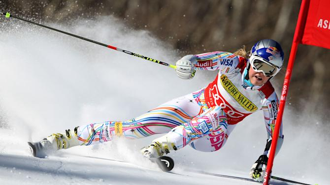 FILE - This Nov. 26, 2011 file photo shows United States' Lindsey Vonn skiing during her first run at the Woman's World Cup Giant Slalom Ski competition in Aspen, Colo. The four-time overall World Cup champion recently had her request to compete in a men's World Cup downhill race denied by the International Ski Federation.  (AP Photo/Alessandro Trovati)