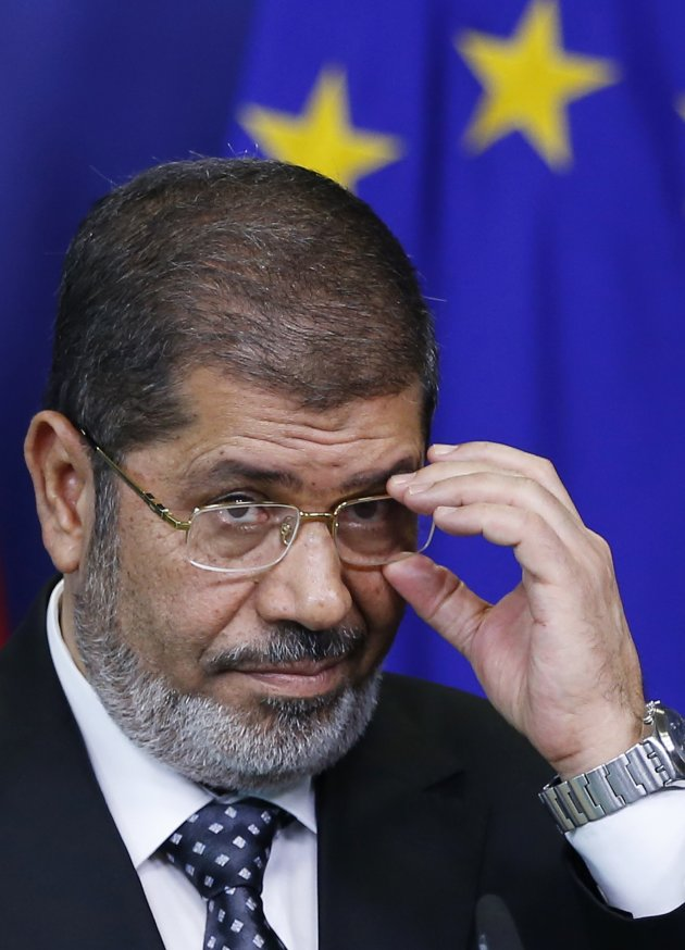 Egypt's President Mohamed Mursi answers reporters' questions after meeting European Commission President Jose Manuel Barroso (unseen) at the EU Commission headquarters in Brussels September 13, 2012.