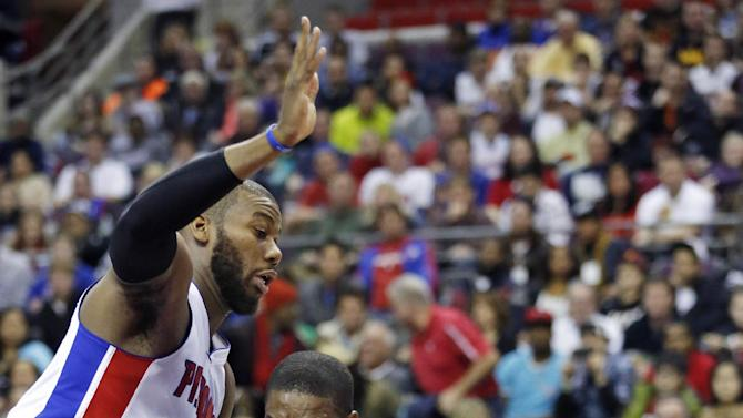 Miami Heat center Chris Bosh, right, drives against Detroit Pistons center Greg Monroe in the first half of an NBA basketball game Friday, Dec. 28, 2012, in Auburn Hills, Mich. (AP Photo/Duane Burleson)