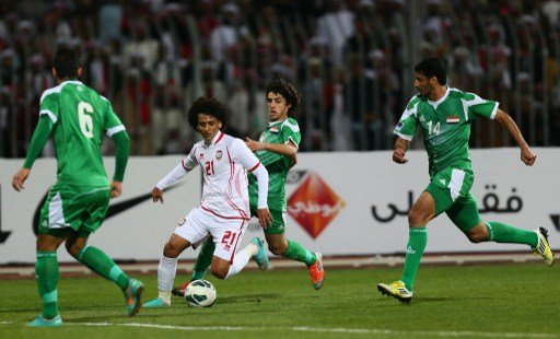 Emirati player Omar Abdul Rahman (C) dribbles past Humam Tariq Faraj ( back) Salam Shaker (R) and Ali Adnan al-Tameemi of Iraq during their 21st Gulf Cup football match final in Manama, on January 18,