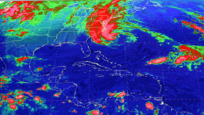 This satellite image from the National Hurricane Center in Miami shows Sandy, at 10:03 a.m., Sunday, Oct. 28, 2012. Hurricane Sandy was headed north from the Caribbean, where it left nearly five dozen dead, to meet a winter storm and a cold front, plus high tides from a full moon, and experts said the rare hybrid storm that results will cause havoc over 800 miles from the East Coast to the Great Lakes. (AP Photo/National Hurricane Center)