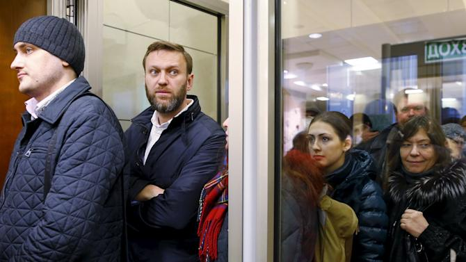 Russian anti-corruption campaigner and opposition figure Alexei Navalny stands in line prior to a hearing at the Moscow City Court in Moscow