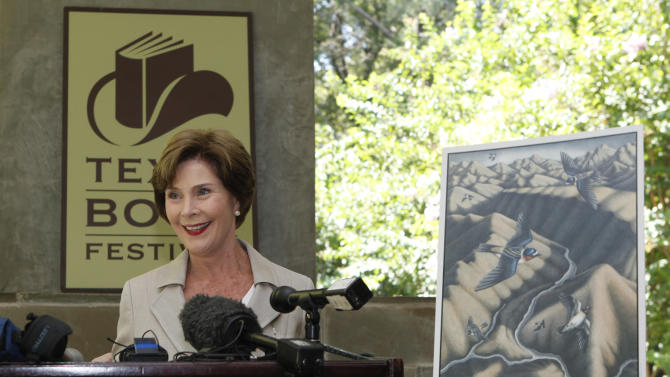 Former first lady Laura Bush speaks at a announcement of the lineup for the 2012 Texas Book festival Wednesday, Sept. 12, 2012, at her home in the Preston Hollow section of Dallas.  Bush, who founded the festival when she was first lady of Texas, also unveiled this year's book festival poster for the annual event in Austin. (AP Photo/LM Otero)