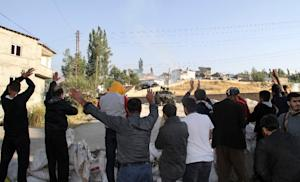 Kurds people hold up their hands  during clashes between…