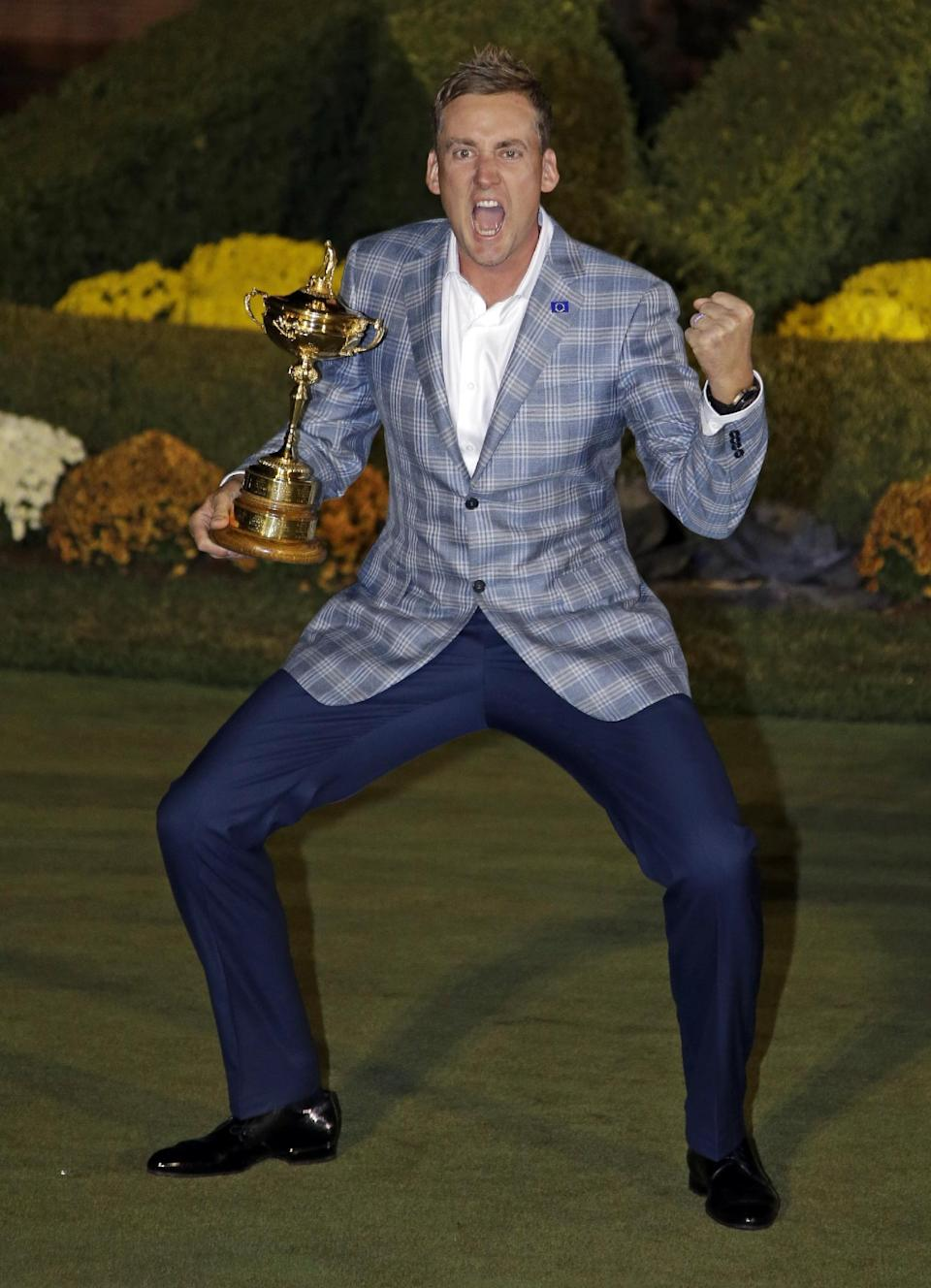 Europe's Ian Poulter celebrates with the trophy after winning the Ryder Cup PGA golf tournament Sunday, Sept. 30, 2012, at the Medinah Country Club in Medinah, Ill. (AP Photo/Chris Carlson)