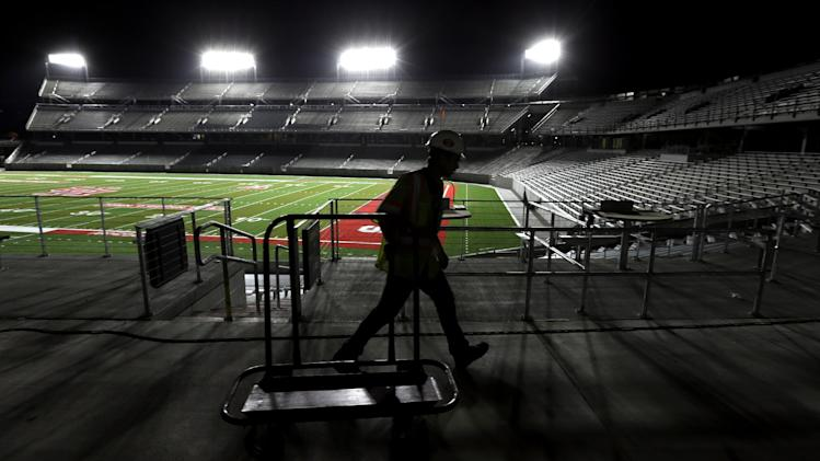 A worker passes by inside TDECU Stadium, the new football stadium for the NCAA college football Houston Cougars, Wednesday, Aug. 20, 2014, in Houston. Houston will open their season in the new stadium Friday, Aug. 29th when they play Texas-San Antonio