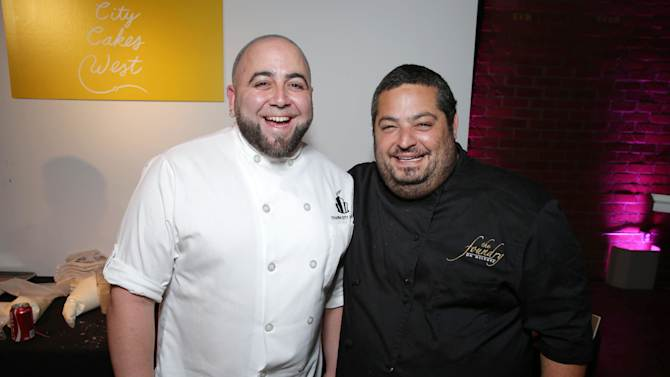 Chef Duff Goldman of Ace of Cakes and Chef Eric Greenspan of The Foundry on Melrose at LA Family Housing Awards 2013, on Thursday, April, 25, 2013 in Culver City, Calif. (Photo by Eric Charbonneau/Invision for Warner Bros./AP Images)