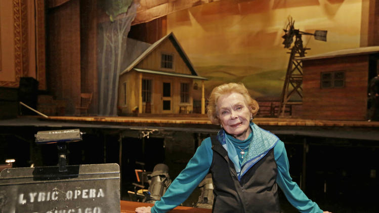 "In this April 26, 2013 photo, choreographer Gemze de Lappe  stands by the set of Rodgers and Hammerstein's ""Oklahoma!"" at the Lyric Opera of Chicago. De Lappe first danced in ""Oklahoma!"" in 1943 as a member of the Broadway hit's first national touring company and now 70 years later at age 91 she's choreographing a production of the musical at the Lyric. (AP Photo/M. Spencer Green)"