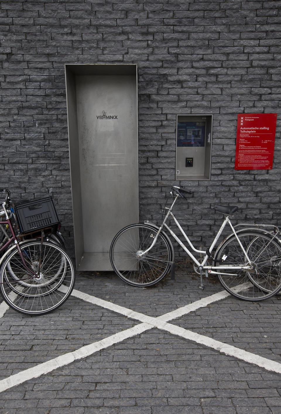 Parked bicycles block the entrance to a 50-place underground bicycle parking in Amsterdam Noord, across IJ river, Netherlands, Wednesday Oct. 31, 2012. (AP Photo/Peter Dejong)