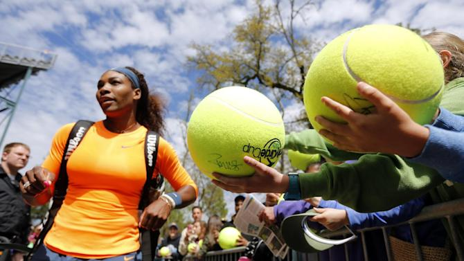 Serena Williams walks the autograph line after her match against Mallory Burdette at the Family Circle Cup tennis tournament in Charleston, S.C., Friday, April 5, 2013.  Williams won 6-4, 6-2. (AP Photo/Mic Smith)