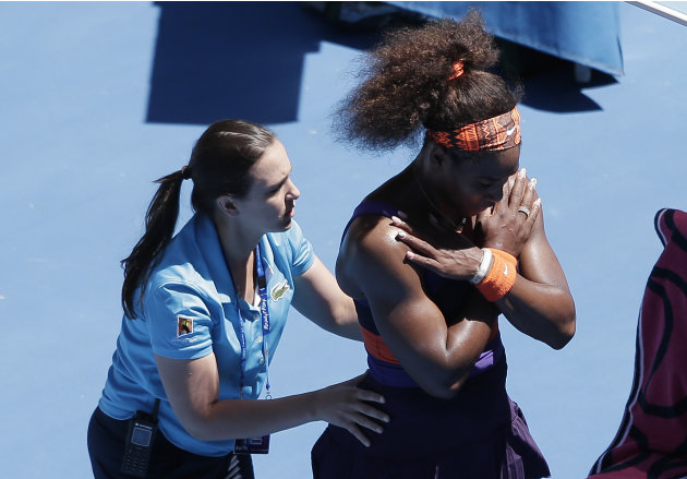 Serena Williams of the US receives treatment  from a trainer during her quarterfinal match against compatriot Sloane Stephens at the Australian Open tennis championship in Melbourne, Australia, Wednes