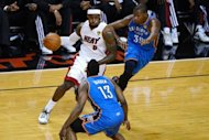 Miami Heat's LeBron James (L) gets past Oklahoma City Thunder's James Harden (front) and Kevin Durant during game three of the NBA Finals on June 17. Miami beat Oklahoma City 91-85 to take the lead in the NBA Finals