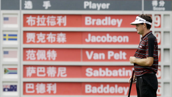 Keegan Bradley of the U.S. stands in front of the scoreboard at the 4th green during the second round of the HSBC Champions golf tournament in Shanghai, China Friday, Nov. 4, 2011. (AP Photo/Eugene Hoshiko)
