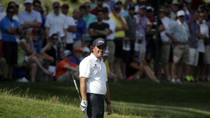 Phil Mickelson reacts to his shot on the sixth hole during the third round of the U.S. Open golf tournament at Merion Golf Club, Saturday, June 15, 2013, in Ardmore, Pa. (AP Photo/Charlie Riedel)