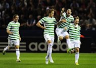 Celtic&#39;s Kris Commons (R) celebrates his goal with teammates Adam Matthews (L), Thomas Rogne and Beram Kayal (2nd R) during the Champions League playoff football match between Helsingborgs and Celtic at the Olympia Stadium in Helsingborg. Celtic won 2-0