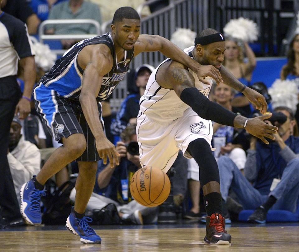 Orlando Magic guard E'Twaun Moore, left, steals the ball from Miami Heat forward LeBron James during the second half of an NBA basketball game in Orlando, Fla., Monday, March 25, 2013. The Heat won 108-94. (AP Photo/Phelan M. Ebenhack)
