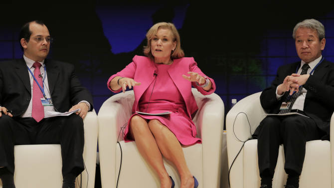 Sweden's Minister of International Development Cooperation Gunilla Carlsson, center, speaks as Peru's Finance Minister Luis Miguel Castilla, left, and President of the Japan International Cooperation Agency(JICA) Akihito Tanaka listen at a seminar during the annual meetings of the IMF and World Bank in Tokyo, Saturday, Oct. 13, 2012.(AP Photo/Itsuo Inouye)
